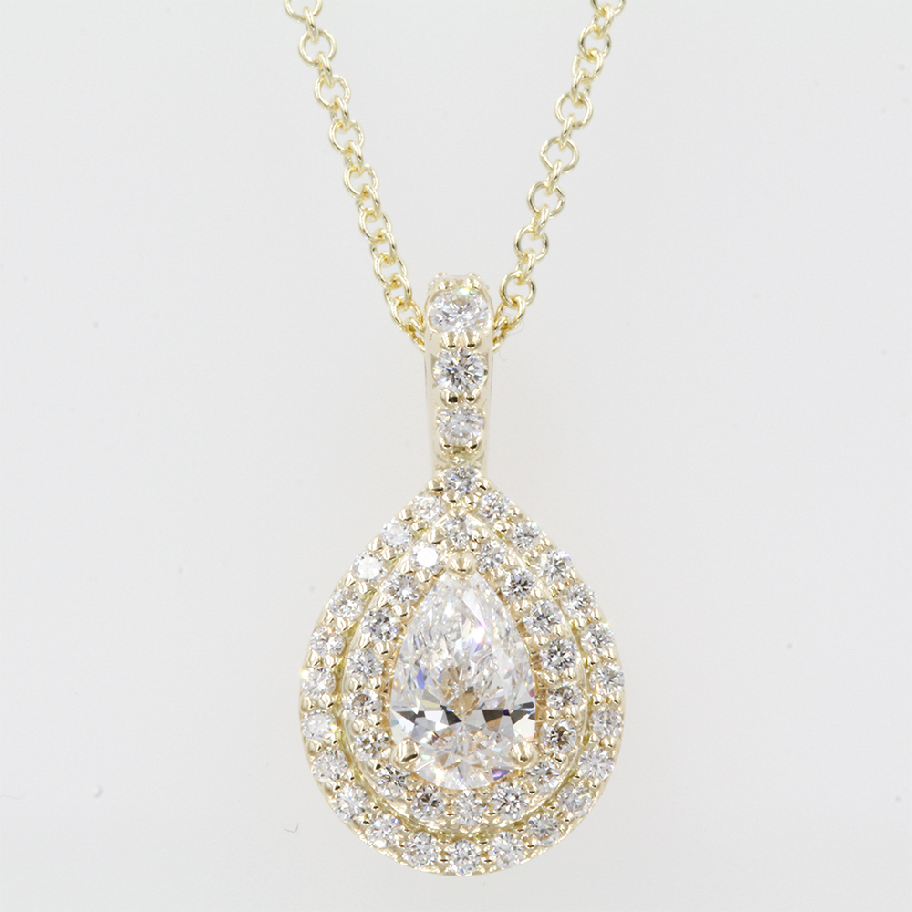 0.70 carat pear diamond halo pendant in FDPD86826PE