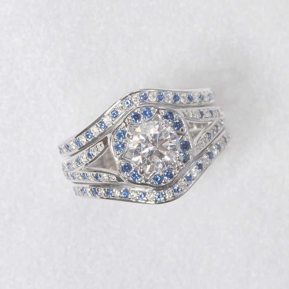 round cut floral halo split diamond wedding ring set with blue sapphire in FDENS3259RO.jpg