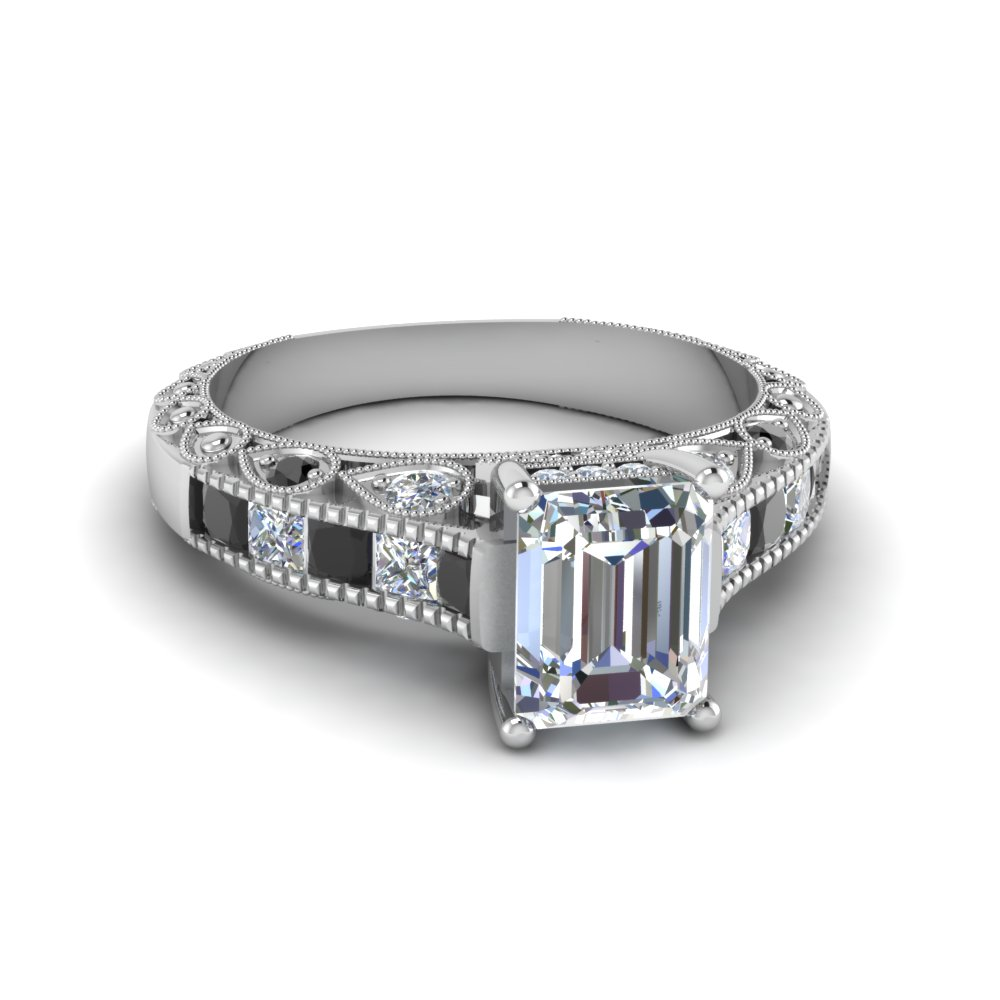 emerald cut antique channel set shank engagement ring with