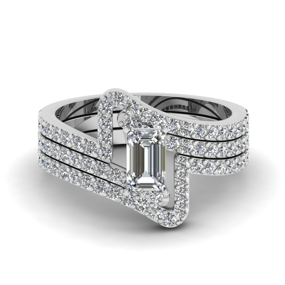 Crossover emerald cut diamond trio wedding ring set in 950 for Wedding bands and engagement ring sets