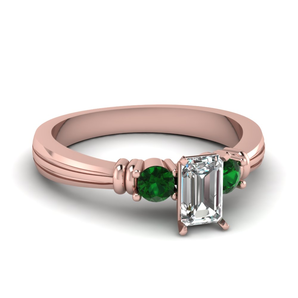 Delicate Emerald Three Stone Ring