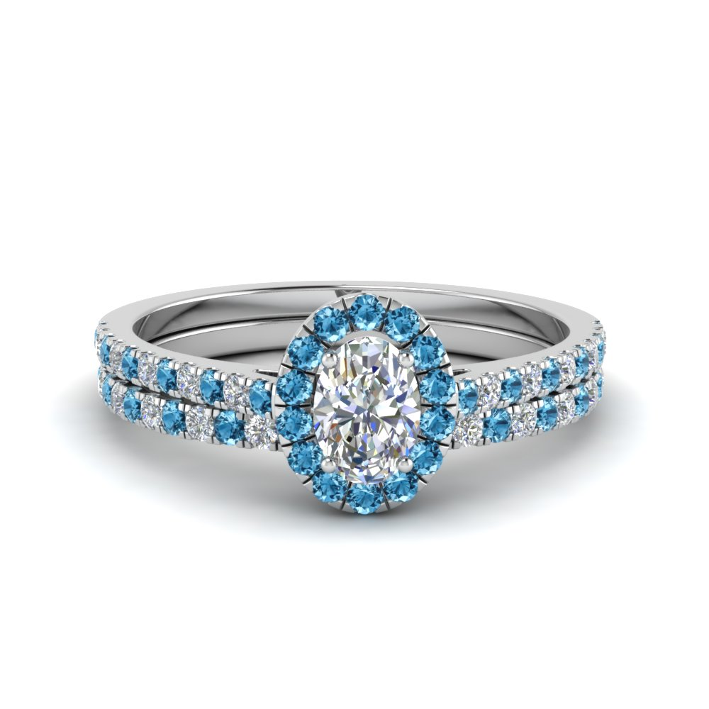 french pave oval halo diamond bridal set with ice blue topaz in