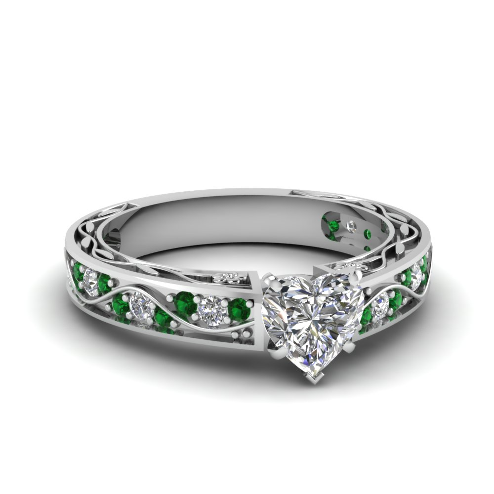 with side diamond stones tapered engagement cut white platinum rings ring emerald in center three baguette stone and