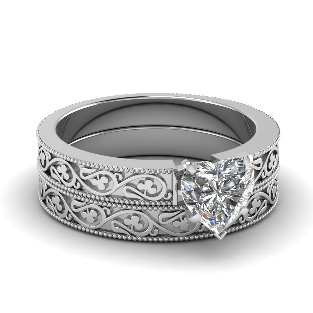 heart shaped diamond wedding ring set in 14k white gold