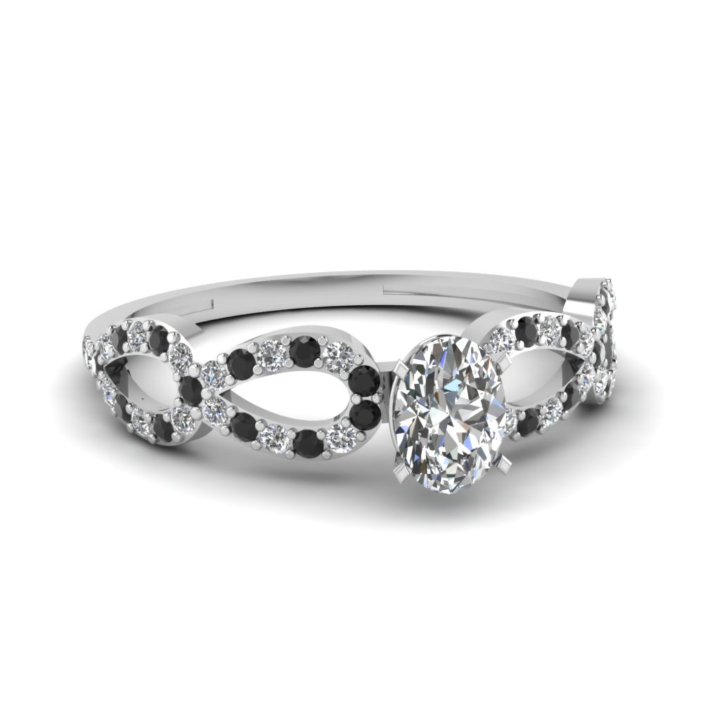 Black Diamond And Oval Shaped Diamond Engagement Ring