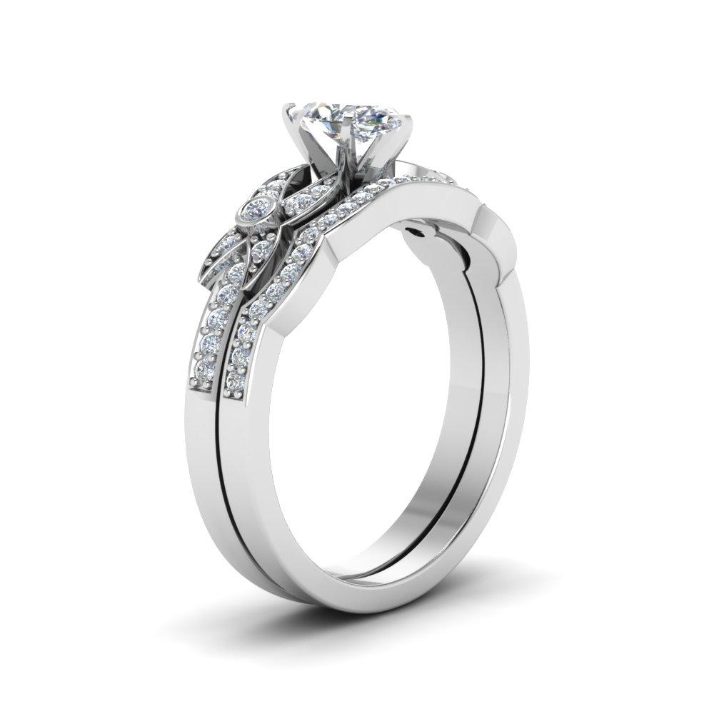 Shop marquise cut flower pave diamond wedding ring set in 14k white gold at Fascinating Diamonds. This diamond engagement ring is designed in Pave
