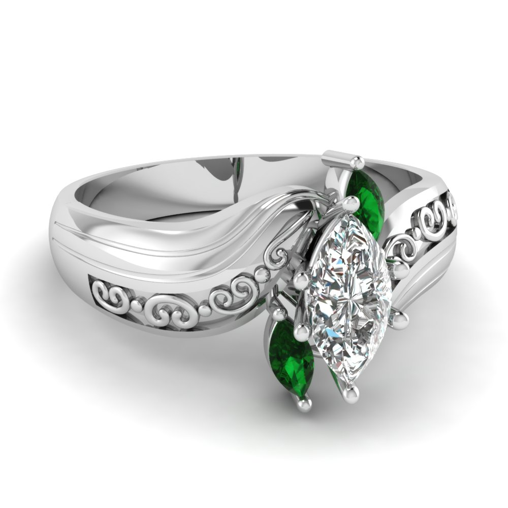 marquise three diamond engagement ring with emerald in 14k white