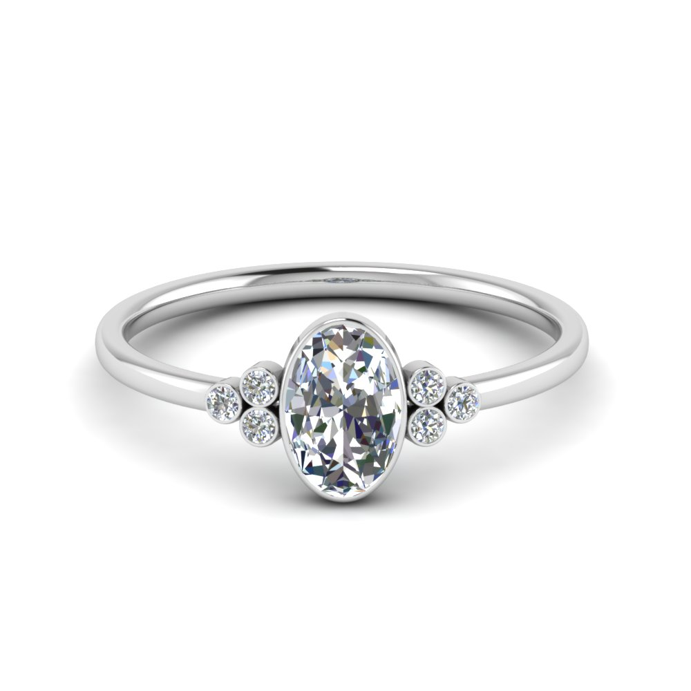 oval bezel set moissanite engagement ring in FD9175OVRHAND NL WG