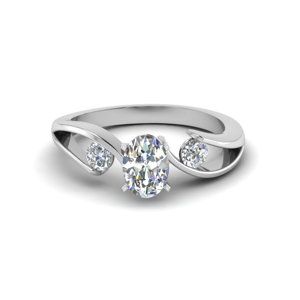 Platinum Oval Shaped Three Stone Ring