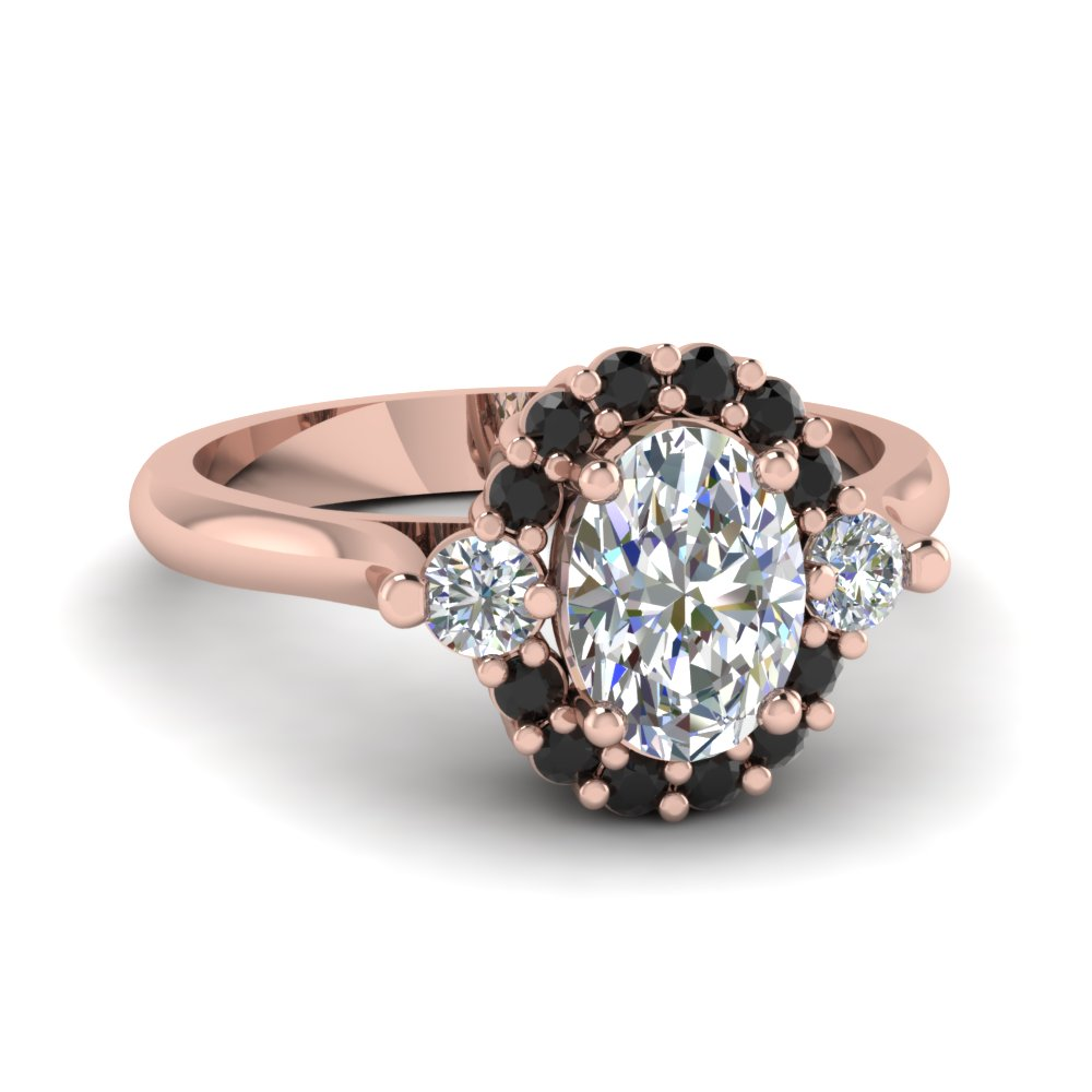 oval shaped diamond engagement ring with black diamond in 14k rose