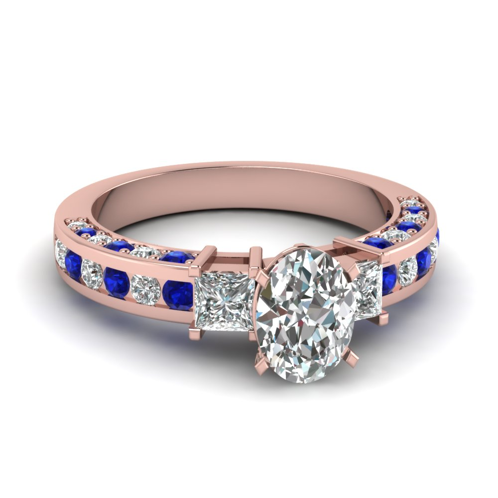 Prong Set Oval Diamond And Sapphire Ring