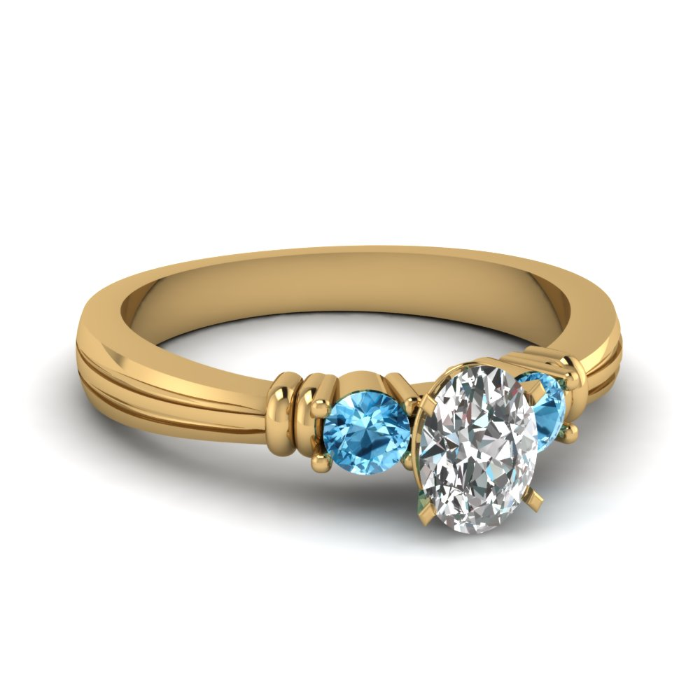 Oval Shaped Blue Topaz 3 Stone Ring