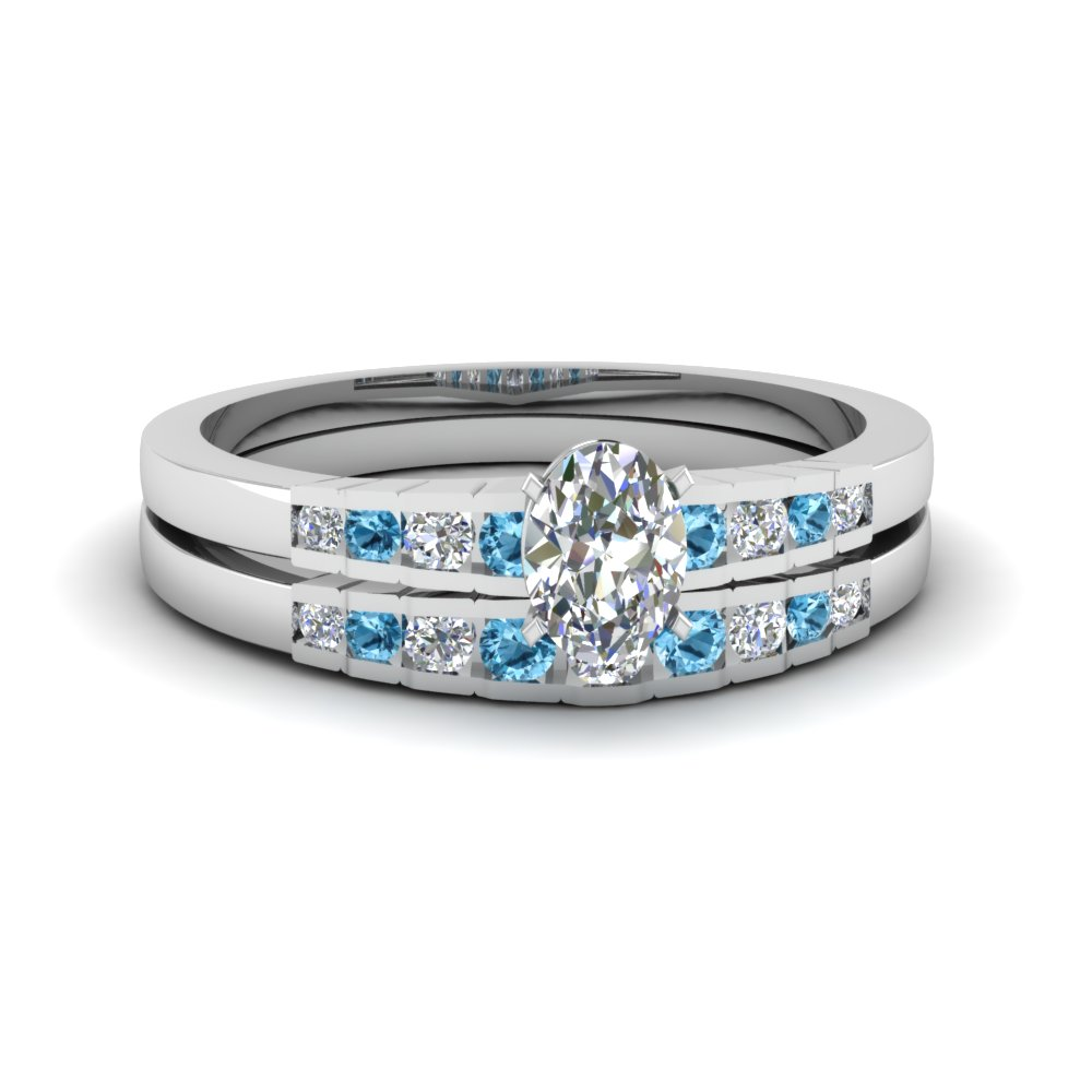 oval shaped diamond graduated accent wedding set with blue topaz in FDENS3116OVGICBLTO NL WG