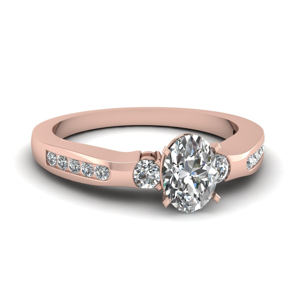 Rose Gold Oval Shaped Diamond Side Stone Rings