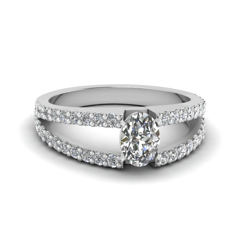 Oval Shaped Diamond Ring With Round Accents