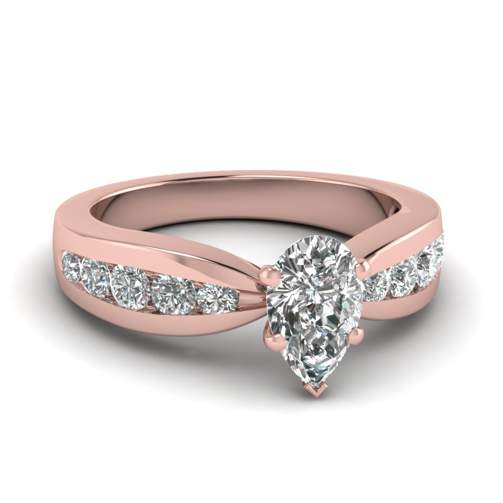 Pear Shaped Diamond Ring With Round Accents