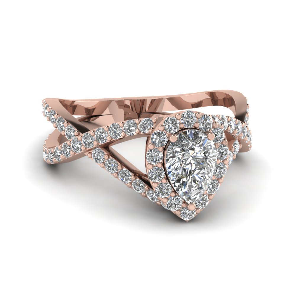 pear shaped diamond engagement ring in 18k rose gold | fascinating