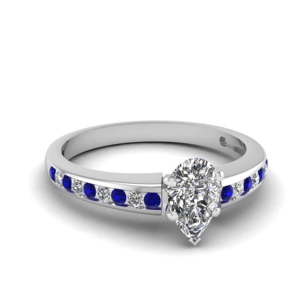Pear Shaped Diamond And Sapphire Womens Engagement Ring
