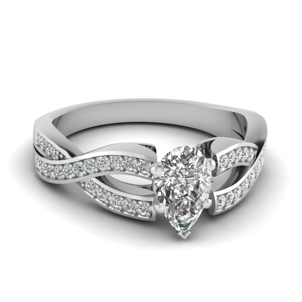 Pave Set Round Diamond Accented Pear Cut Engagement Ring