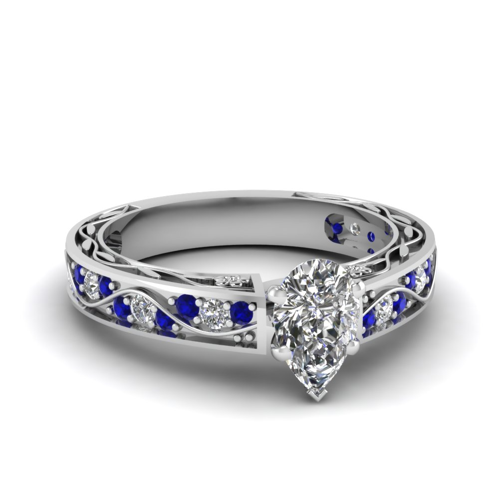 Pear Shaped Diamond Shank Wave Side Stone Engagement Ring With Blue  Sapphire In 14k White Gold