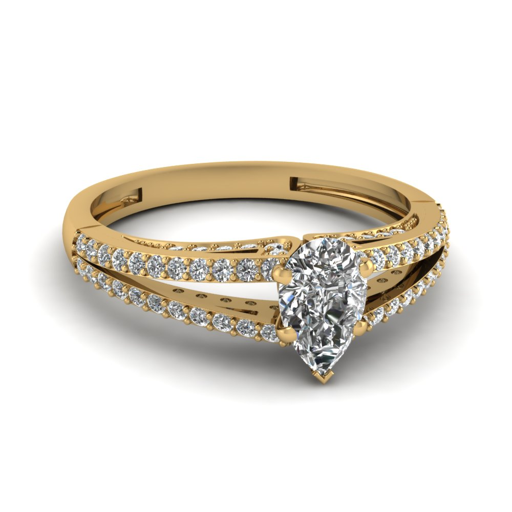 Pear Shaped Diamond Side Stone Engagement Ring