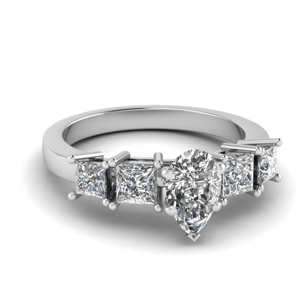 Platinum Side Stone Engagement Ring With Pear Shaped Diamond