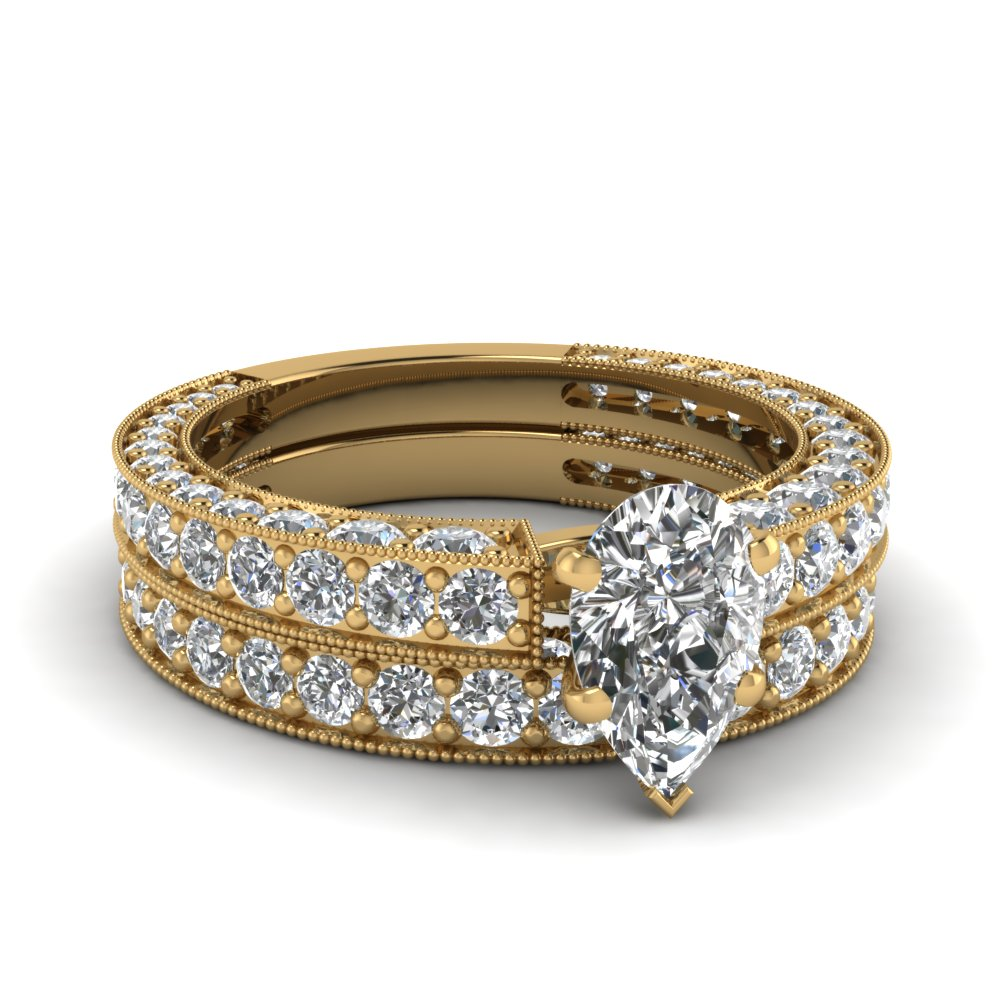 Pear Shaped Diamond Wedding Ring Set In 14K Yellow Gold