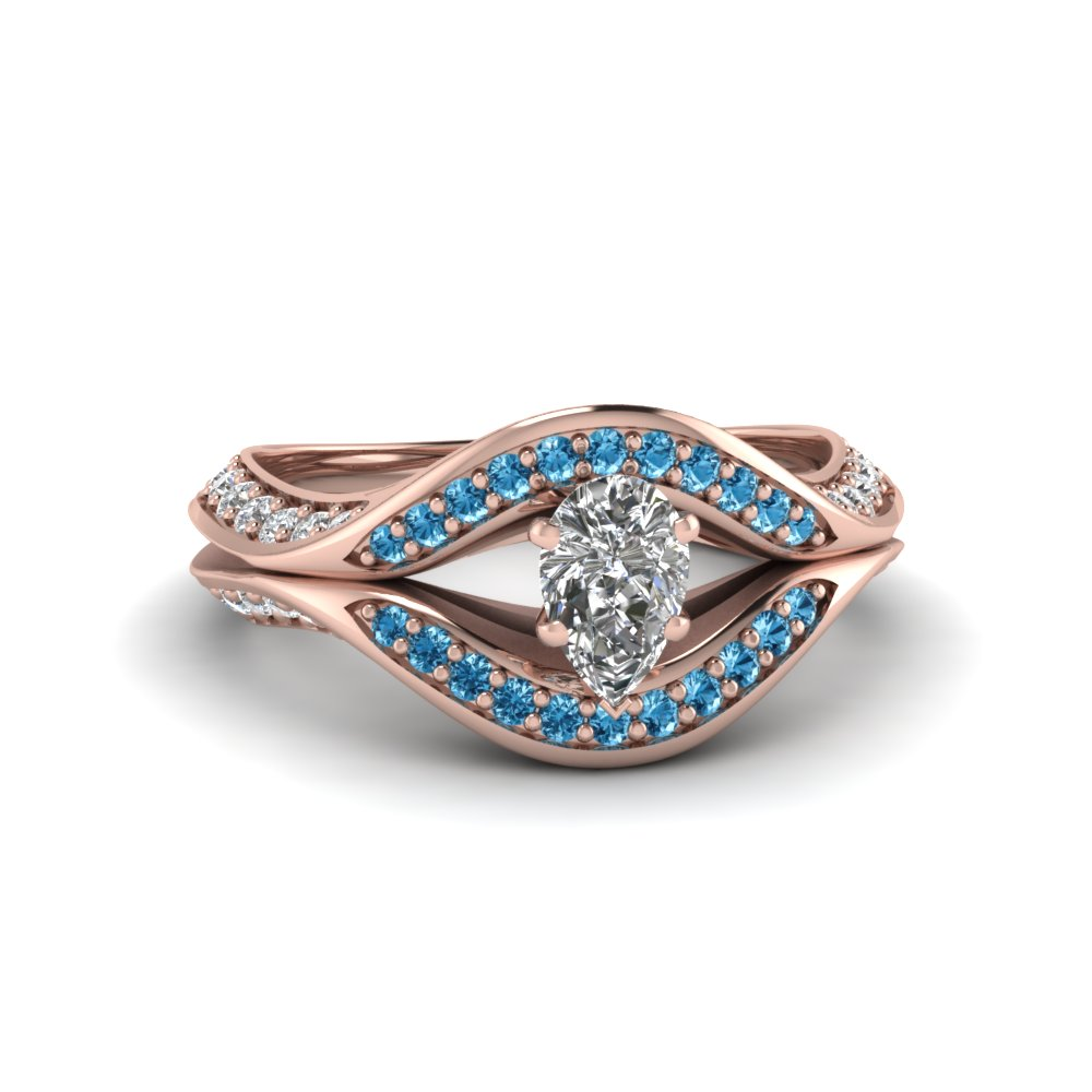 Pear Shaped Blue Topaz Halo Engagement Rings