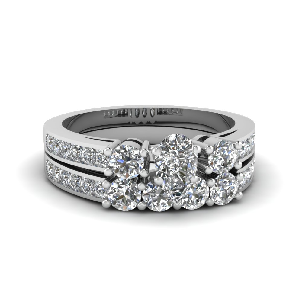Pear Shaped Three Stone Diamond Channel Wedding Set In 950