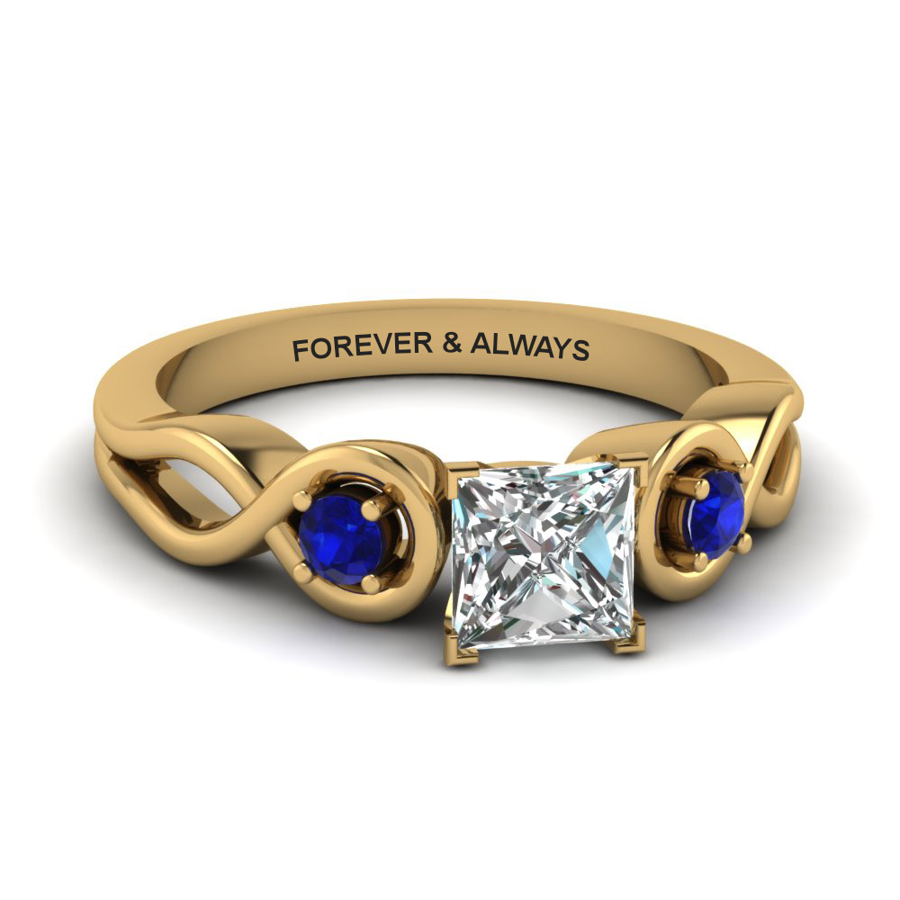 princess cut engraved three stone diamond engagement ring with blue sapphire in 14K yellow gold FD1154PRRGSABL NL YG