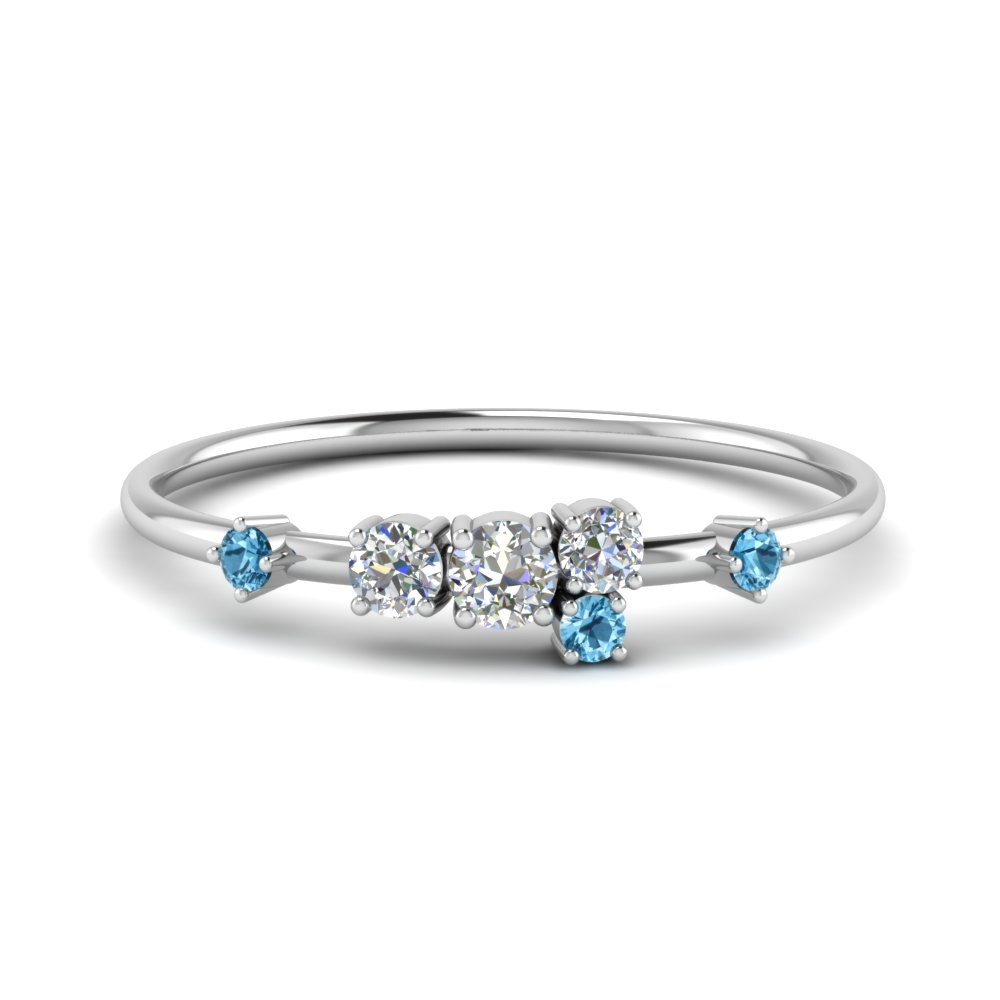 Round Cut Asymmetrical Diamond Engagement Ring With Ice Blue Topaz In 18K White Gold