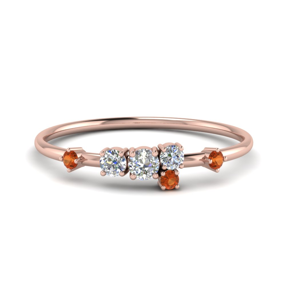 Round Cut Asymmetrical Diamond Engagement Ring With Orange Sapphire In 14K Rose Gold