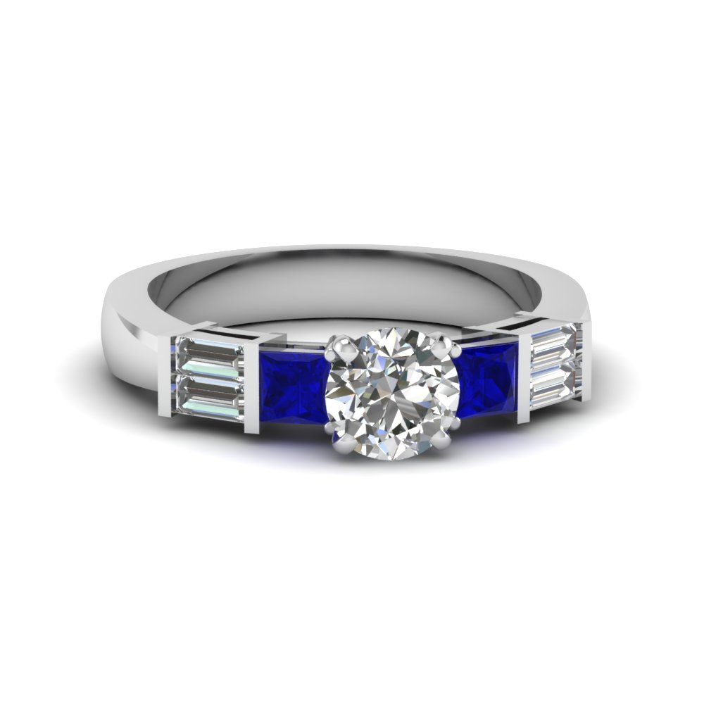 Baguette Accented Round Cut Diamond And Sapphire Engagement Ring