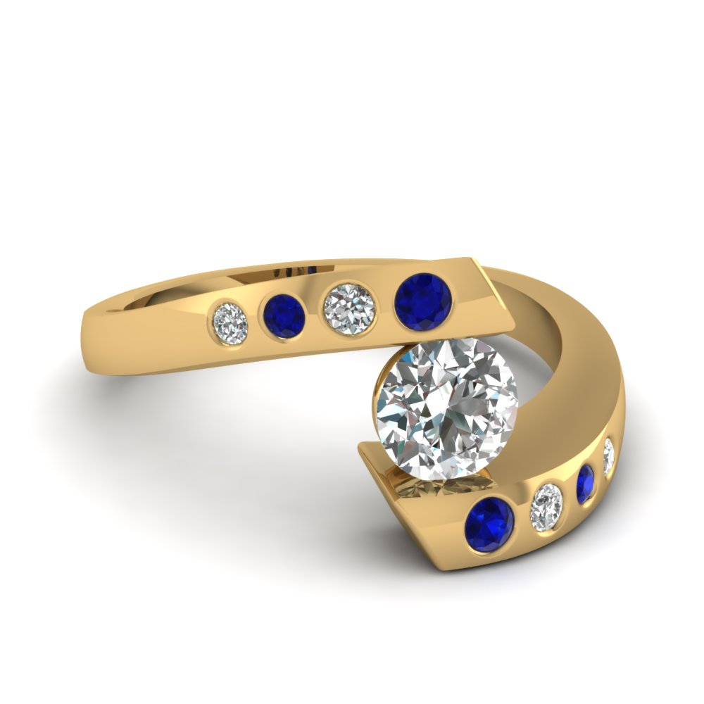 Round Cut Diamond Engagement Ring With Blue Sapphire In 14K Yellow Gold