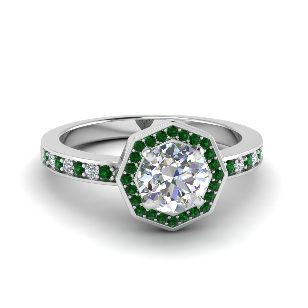 round cut pave diamond halo engagement ring with emerald