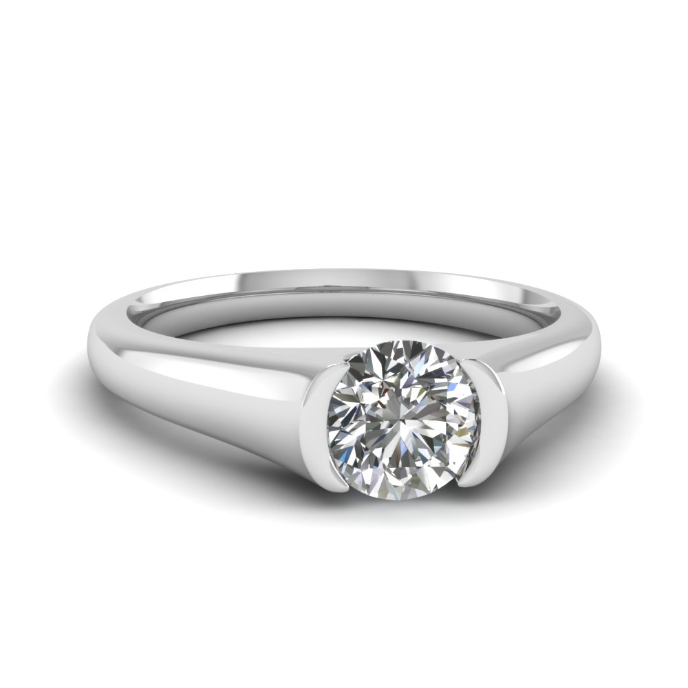 round robinson diamond brilliant platinum bezel head shank with owen set image solitaire
